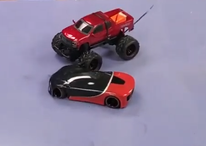 two remote controlled cars colliding